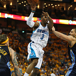 25 April 2009: New Orleans Hornets guard Chris Paul (3) passes the ball between Denver Nuggets defenders during a NBA Western Conference quarter-finals playoff game between the New Orleans Hornets and the Denver Nuggets at the New Orleans Arena in New Orleans, Louisiana.
