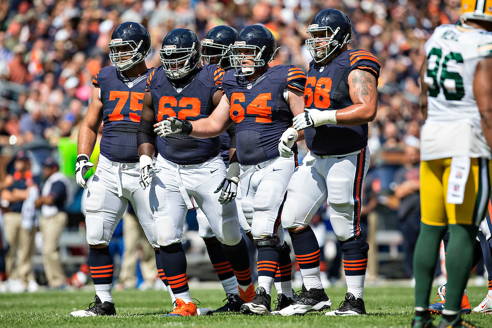 CHICAGO, IL - SEPTEMBER 13:  Matt Slauson #68, Will Montgomery #64, Vladimir Ducasse #62 and Kyle Long #75 of the Chicago Bears walks to the line of scrimmage during a game against the Green Bay Packers at Soldier Field on September 13, 2015 in Chicago, Illinois.  The Packers defeated the Bears 31-23.  (Photo by Wesley Hitt/Getty Images) *** Local Caption *** Matt Slauson; Will Montgomery; Vladimir Ducasse; Kyle Long