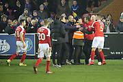 Charlton Athletic Manager Karl Robinson held back by stewards during the EFL Sky Bet League 1 match between AFC Wimbledon and Charlton Athletic at the Cherry Red Records Stadium, Kingston, England on 11 February 2017. Photo by Matthew Redman.