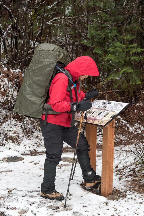 Backpacker cleaning boots at a trailhead to avoid spreading noxious weeds into Idaho's Selway-Bitterroot Wilderness.