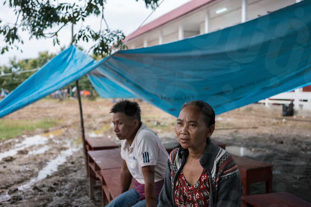 August 05, 2018 - Attapeu (Laos). Ms. Vee (54) during an interview inside the temporary shelter used by her family in Sanamxai's district. Because of the floods, she lost her 27 years old son and 5 years old grandson. The body of his grandson is still missing. According to Lao authorities 34 people have been confirmed dead and 131 are still missing. © Thomas Cristofoletti / Ruom