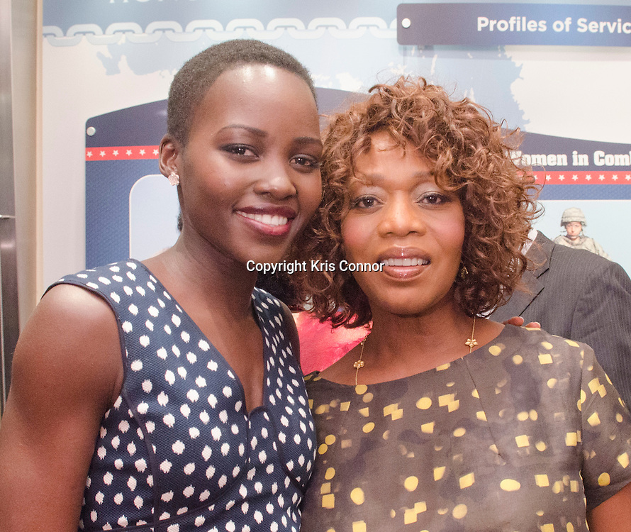 Actresses Alfre Woodard and Lupita Nyong'o attend a reception and Q&A panel discussion during the DC screening of 12 Years a Slave at The Naval Heritage Center, Burke Theater in Washington DC on September 18, 2013. Juan Williams moderated the Q&A panel discussion. Photo by Kris Connor for Fox Searchlight