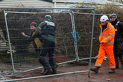 Harefield, UK. 16 January, 2020. An enforcement agent working on behalf of HS2 prevents Stop HS2 activist Mark Keir from reentering the Harvil Road wildlife protection camp in the Colne Valley after he brought out dogs belonging to a fellow activist evicted earlier in the morning from the camp after over two days and two nights spent in a tree in woodland.