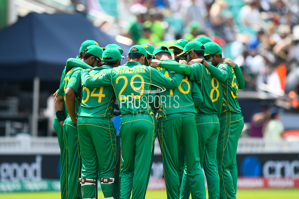 Pakistan in a huddle before fielding against India during the ICC Champions Trophy final match between Pakistan and India at the Oval, London, United Kingdom on 18 June 2017. Photo by Graham Hunt.