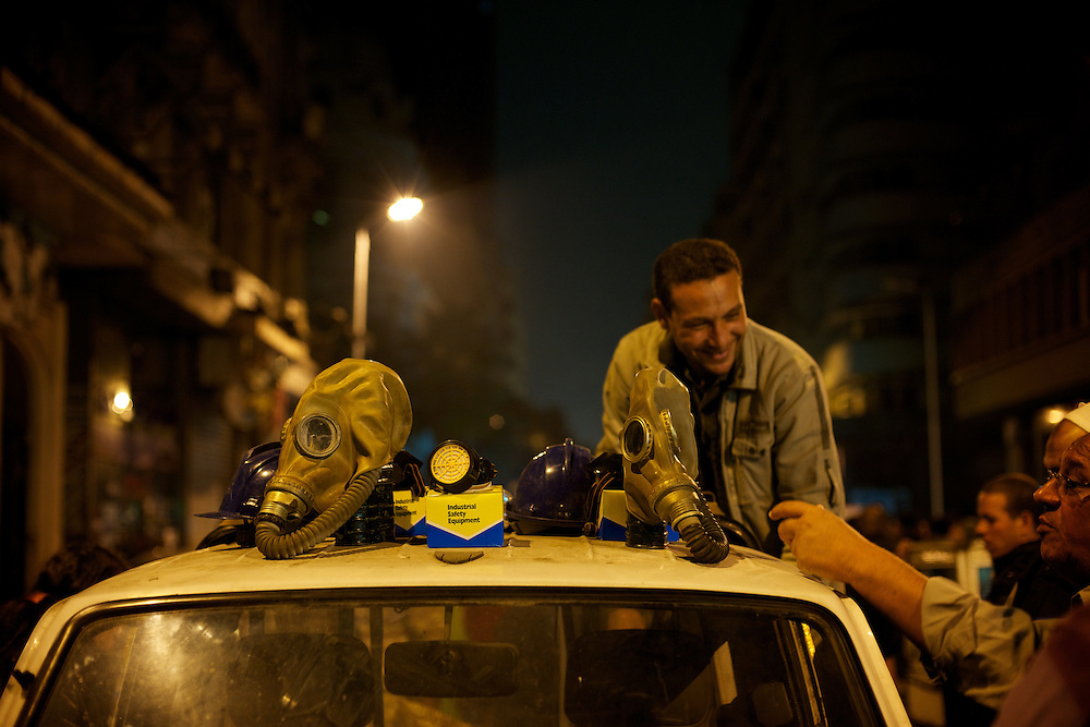 A man sells anti gas masks near Cairo's Tahrir Square