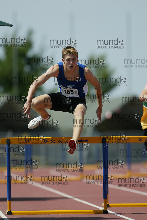 (Sherbrooke, Quebec -- 9 Aug 2009)  Cameron Maclennan of Nova Scotia competes in 300m / 400m hurdles at the 2009 Legion Youth National Track and Field Championships. Photograph copyright Sean Burges / Mundo Sport Images  2009.