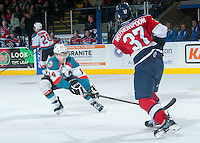 KELOWNA, CANADA - MARCH 28: Rourke Chartier #14 of Kelowna Rockets blocks a pass by Parker Wotherspoon #37 of Tri-City Americans on March 28, 2015 at Prospera Place in Kelowna, British Columbia, Canada.  (Photo by Marissa Baecker/Shoot the Breeze)  *** Local Caption *** Rourke Chartier; Parker Wotherspoon;