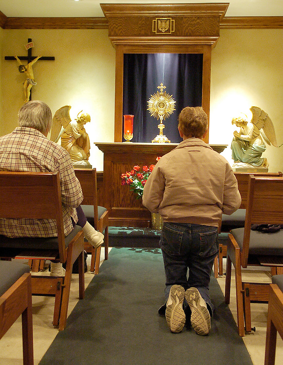 ADORATION CHAPEL -- Members of Our Lady of Good Hope Parish in Milwaukee spend time before the Blessed Sacrament inside an adoration chapel at the church. Adoration has been held at the church for about five years. (Photo by Sam Lucero)