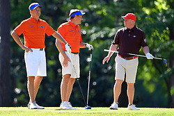Dan Mullen talks to David Dukes during the Chick-fil-A Peach Bowl Challenge at the Oconee Golf Course at Reynolds Plantation, Sunday, May 1, 2018, in Greensboro, Georgia. (Dale Zanine via Abell Images for Chick-fil-A Peach Bowl Challenge)