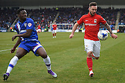 Coventry City forward Adam Armstrong and Gillingham defender Deji Oshilaja during the Sky Bet League 1 match between Gillingham and Coventry City at the MEMS Priestfield Stadium, Gillingham, England on 2 April 2016. Photo by Martin Cole.