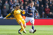 Brighton and Hove Albion midfielder Beram Kayal (7) battles with Millwall midfielder Jed Wallace (7)  during the The FA Cup quarter final match between Millwall and Brighton and Hove Albion at The Den, London, England on 17 March 2019.
