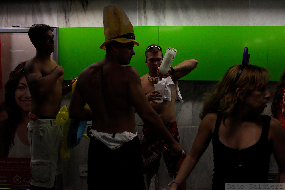 Party goers warm up for the main days of carnival holiday as they use the metro to head to the Sambadrome in Rio de Janeiro, Sunday, Feb. 19, 2012. (Photo Dado Galdieri)