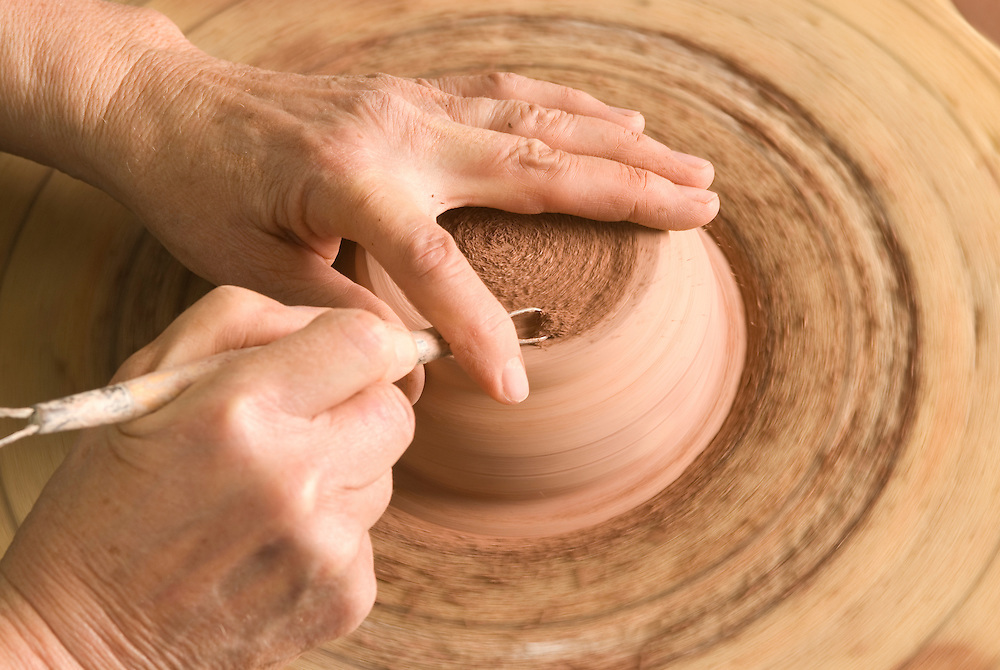 Women Shaping clay bowl