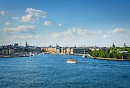 Vy över Stockholms ström med ångbåten Norrskär på väg till kajen.