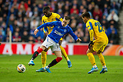 Ryan Kent (#14) of Rangers FC shields the ball from Otavio (#25) of FC Porto and Chancel Mbemba (#19) of FC Porto during the Group G Europa League match between Rangers FC and FC Porto at Ibrox Stadium, Glasgow, Scotland on 7 November 2019.