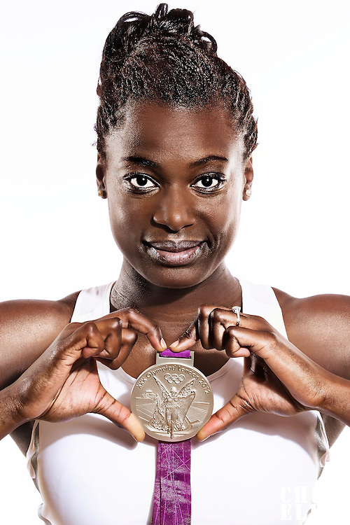 14 August 2012:  Olympic Silver Medalist Jennifer Digbeu (Team France Basketball) poses with her silver medal, at the Hotel Concorde Lafayette, in Paris, France.