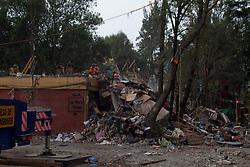 Edificio di cinque piani crollato pochi secondi dopo la scossa.