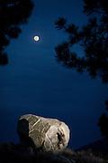 Nolan Smythe does a little moonlight bouldering. <br /> Mammoth Lakes, California