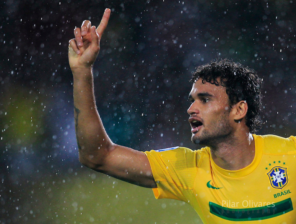 Brazil's Willian celebrates after scoring a goal against Spain during their U-20 World Cup quarterfinal soccer match in Pereira, August 14, 2011.    REUTERS/Pilar Olivares (COLOMBIA - Tags: SPORT SOCCER)