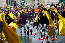 © Licensed to London News Pictures. 01/01/2017. London, UK. Performers participate in London's New Year's Day Parade, the event is one of the world's great street spectaculars with up to 10,000 performers from around the world and hosts marching bands, cheerleaders, leading companies, unions and local boroughs celebrating the arrival of 2017. Photo credit: Tolga Akmen/LNP