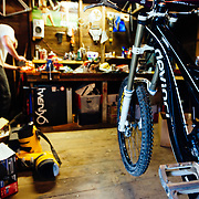 Owen Dudley working on his bike before headin out of Bellingham, Washington.
