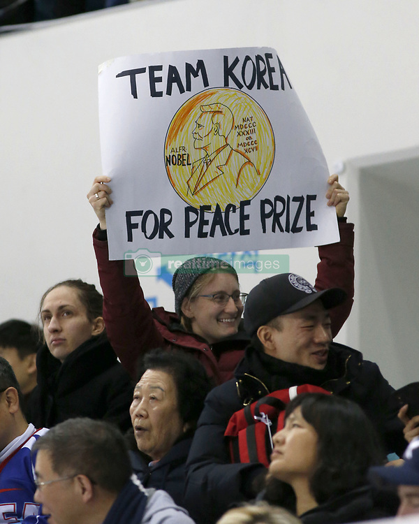 February 18, 2018 - Pyeongchang, KOREA - A fan holds a Peace Prize sign at the hockey game between Switzerland and Korea during the Pyeongchang 2018 Olympic Winter Games at Kwandong Hockey Centre. Switzerland beat Korea 2-0. (Credit Image: © David McIntyre via ZUMA Wire)