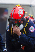 "22 SEPTEMBER 2011 - NEW YORK, NY: An exhausted recovery worker at ""Ground Zero"" of the World Trade Center complex after the WTC terrorist attack, Sept. 22, 2001.  More than 2,900 people were killed when terrorists crashed two airliners into the towers on Sept. 11, 2001.   PHOTO BY JACK KURTZ"