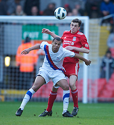 LIVERPOOL, ENGLAND - Saturday, January 8, 2011: Liverpool's Jack Robinson and Crystal Palace's Jake Caprice during the FA Youth Cup 4th Round match at Anfield. (Pic by: David Rawcliffe/Propaganda)