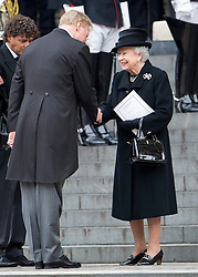 © London News Pictures.17/04/2013. London, UK.  HRH Queen Elizabeth II  being greeted by Mark Thatcher, son of Margaret Thatcher as she leave St Paul's Cathedral in London following the funeral of former British Prime Minister Margaret Thatcher on April 17, 2013. Photo credit : Ben Cawthra/LNP