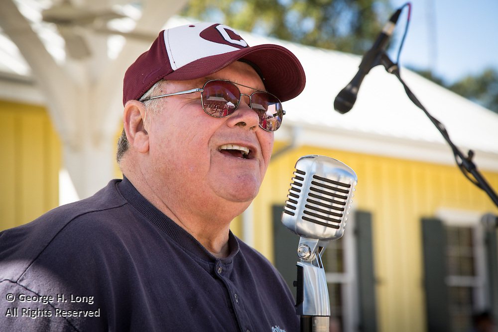 Former Abita Springs mayor Bryan Gowland makes announcements at the 2015 Abita Springs Water Festival