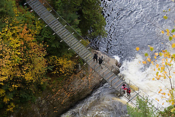 Beaupre, QC, Canada. Bridge over the Canyon Sainte-Anne, a spectacular, steep-sided gorge, carved by the Sainte-Anne-du-Nord River 6 km east of Ste-Anne-de-Beaupre, Quebec, Canada. The river drops over a 80 m. waterfall within the canyon. / Ponte suspensa sobre o Canion Saint-Anne, localizado a 40 km da cidade de Quebec