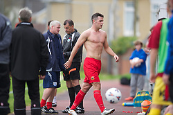LLANELLI, WALES - Saturday, September 15, 2012: Llanelli's Luke Bowen walks off dejected after being shown the red card and sent off by referee A.P. Harms during his side's 3-0 defeat by Newtown during the Welsh Premier League match at Stebonheath Park. (Pic by David Rawcliffe/Propaganda)