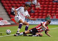 Photo: Alan Crowhurst.<br /> Southampton v Anderlecht, Pre Season Friendly, 30/07/2005. Saints Chris Baird slides in on Christophe Gregoire.