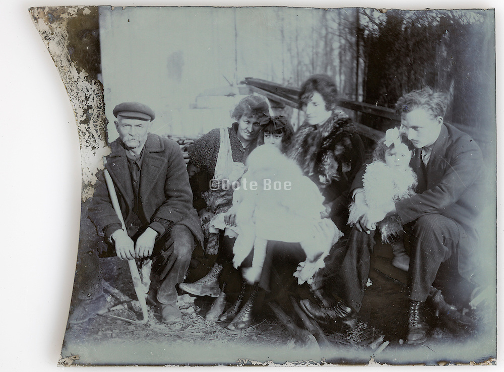 broken and fading glass plate with family portrait Paris 1900s