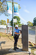 Philadelphia, Pennsylvania - September 17, 2015: Philadelphia police officer Abe Matos, from the traffic division, overrides the traffic lightbox around Eakins Oval Thursday September 17, 2015, to dissolve the morning rush hour traffic. <br /> <br /> <br /> Scott Mirkin's company ESM is heading the production of The World Meeting Of Families and Pope Francis's visit to Philadelphia this Fall. The events will take place along the Benjamin Franklin Parkway.<br /> <br /> CREDIT: Matt Roth for The New York Times<br /> Assignment ID: 30179397A