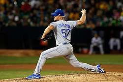 OAKLAND, CA - SEPTEMBER 16: Glenn Sparkman #57 of the Kansas City Royals pitches against the Oakland Athletics during the third inning at the RingCentral Coliseum on September 16, 2019 in Oakland, California. The Kansas City Royals defeated the Oakland Athletics 6-5. (Photo by Jason O. Watson/Getty Images) *** Local Caption *** Glenn Sparkman