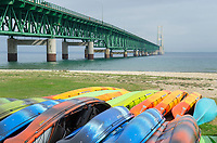 Mackinac Bridge and colorful rental kayaks,Mackinaw City Michigan