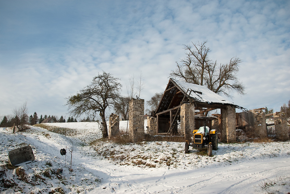 An old farm and tractor in the countryside near the town of Cieszyn, southern Poland.
