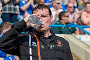 Blackpool manager Gary Bowyer drinks water during the EFL Sky Bet League 1 match between Gillingham and Blackpool at the MEMS Priestfield Stadium, Gillingham, England on 21 April 2018. Picture by Martin Cole.
