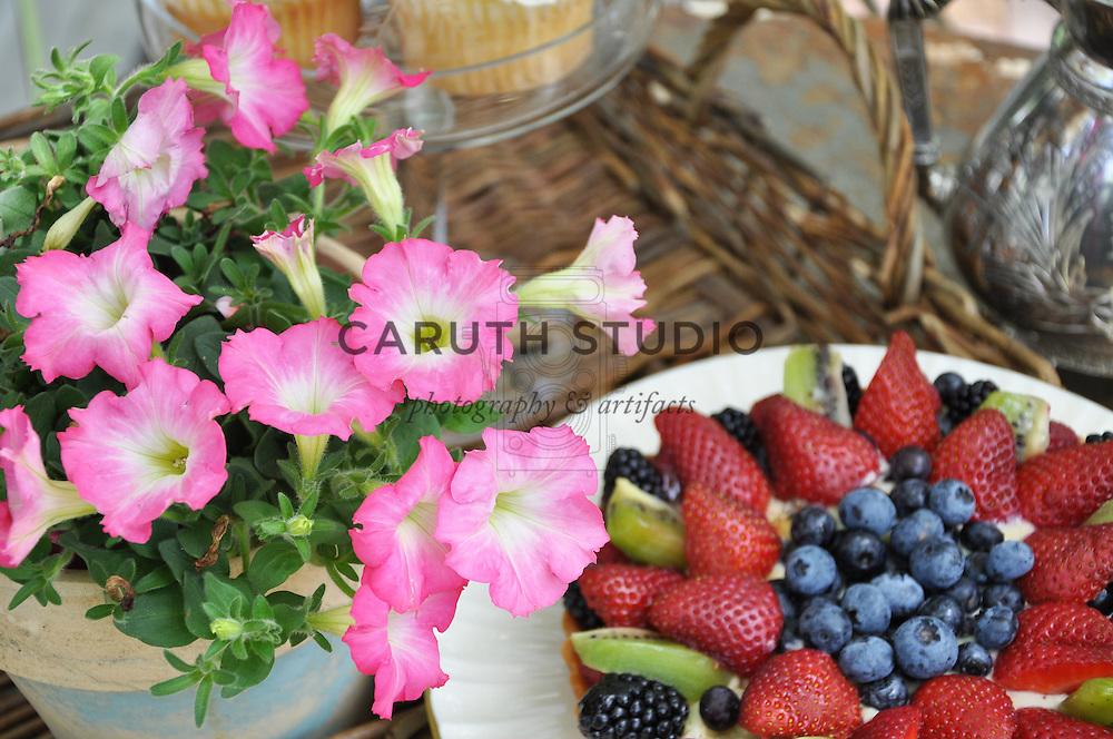 Vintage garden: Detail of tabletop set for tea inside glass shed