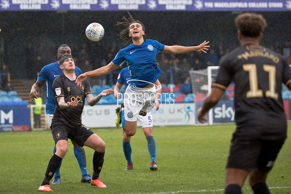 Macclesfield Town defender Miles Welch-Hayes fouled by the opponent  during the EFL Sky Bet League 2 match between Macclesfield Town and Mansfield Town at Moss Rose, Macclesfield, United Kingdom on 16 November 2019.