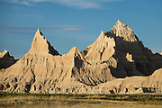 Erosion exposed layers of ancient colorful sediments, on the Loop Road near the Interior Entrance of Badlands National Park, South Dakota, USA. This park has the largest undisturbed mixed grass prairie in the United States.