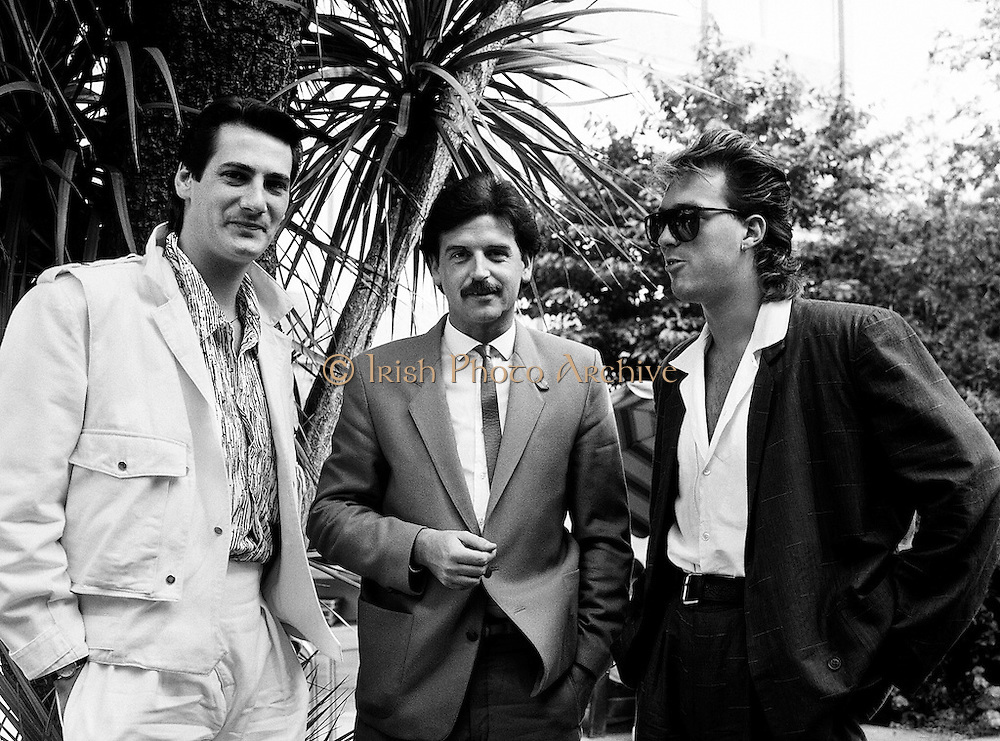 Marty Whelan (centre) with Spandau Ballet members Tony Hadley and Martin Kemp, conducting an interview for Video File for RTÉ.<br /> 21 August 1984