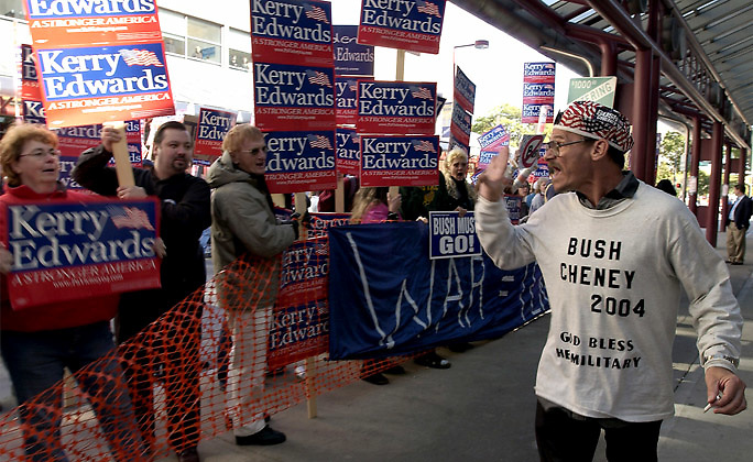An unidentified Bush Supporter is harassed by Kerry fans after leaving the Bush speach in Wilkes BArre.
