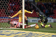 Ball rolls out after Doncaster Rovers Midfielder Tommy Rowe (10) is tackled by Bristol Rovers Defender Marc Bola during the EFL Sky Bet League 1 match between Doncaster Rovers and Bristol Rovers at the Keepmoat Stadium, Doncaster, England on 27 January 2018. Photo by Craig Zadoroznyj.