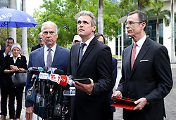 May 1, 2019 - USA - From left- Attorneys Roberto Mart'nez, (former U.S. Attorney for Southern District of Florida) and Rodney S. Margol (back), joined Mickael Behn, who gets emotional as he speaks and Dr. Javier Garcia-Bengochea, holders of certified claims for land in Cuba and the plaintiffs from first lawsuit under Title III Helms-Burton Acton, outside of the Wilkie D. Ferguson, Jr. U.S. Courthouse, as the US President Donald J.Trump administration decided to end the suspension of a law that allows American citizens, including naturalized Cubans, to sue companies and subsidiaries in Cuba that benefited from private properties that were confiscated by the Cuban government, Thursday May 02, 2019. (Credit Image: © TNS via ZUMA Wire)