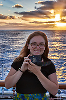 Student photographer at sunrise showing me her selfie otn the deck of the MV World Odyssey. Image taken with a Fuji X-T1 camera and 35 mm f/1.4 lens (ISO 200, 35 mm, f/5.6, 1/125 sec).