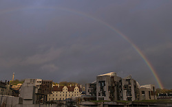 A rainbow arches across the Scottish Parliament building in Edinburgh as rain moves in to central Scotland from the West.
