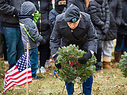 14 DECEMBER 2019 - DES MOINES, IOWA: Captain ELIZABETH OHLOFF, US Army Reserve, lays a wreath to honor Air Force veterans during a ceremony to mark the laying of Christmas wreaths on veterans' graves. Volunteers working with Wreaths Across America placed Christmas wreaths on the headstones of more than 600 US military veterans in Woodland Cemetery in Des Moines. The cemetery, one of the first in Des Moines, has the graves of veterans going back to the War of 1812.       PHOTO BY JACK KURTZ