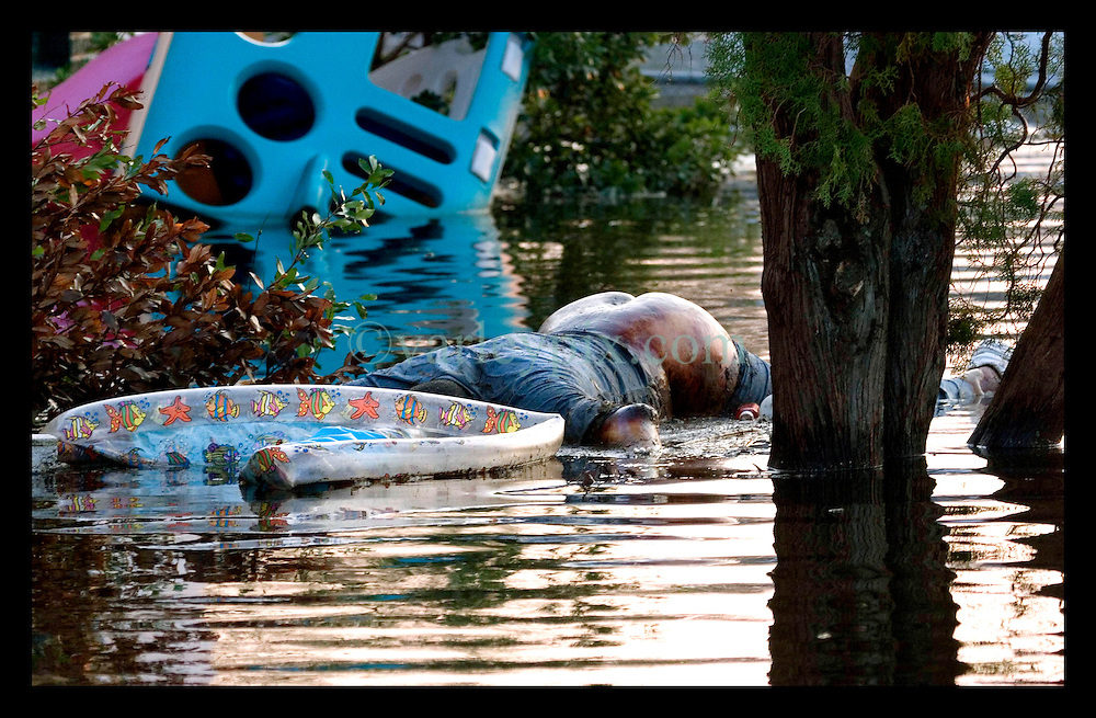 5th Sept, 2005. Hurricane Katrina aftermath. New Orleans. A body floats in the water near Bapist Memorial Hospital in Uptown New Orleans.